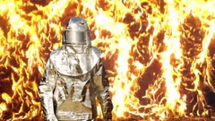 Slow motion firefighter against wall of fire Stock Footage