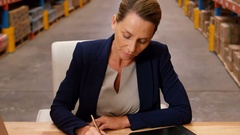 Female manager filling a form Stock Footage