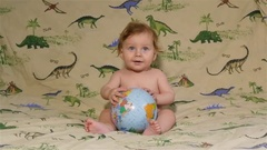 Happy Baby Playing With Terrestrial Globe Stock Footage