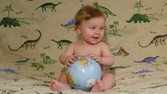 Little Boy Playing With An Globe Stock Footage