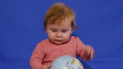 Toodler Playing with a Globe Stock Footage