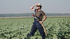 Posing Farmer with Beard Watering Cabbages Stock Footage