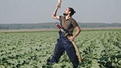 Confident Farmer Striking Pose on Field Stock Footage