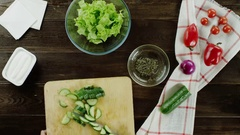 Slices of cucumber is adding to a salad Stock Footage