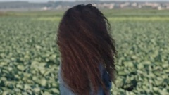 Curly Woman Flicking Hair Outside Stock Footage