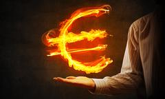 Euro currency fire symbol Stock Photos