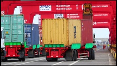 Port Container Trucks moving in to unload Stock Footage