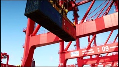 Gantry crane loadeding containers into vessel Stock Footage