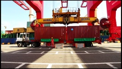 Port containers being loaded into vessel unbranded boxes Stock Footage