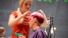 Woman creates hairdressers hair girl model Stock Footage