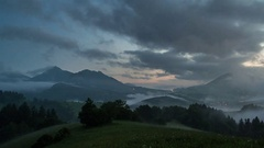 Foggy Evening with Moving Clouds after Sunset Time Lapse. Stock Footage