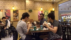 Customers ordering and eating  sandwiches at Subway Restaurant Stock Footage