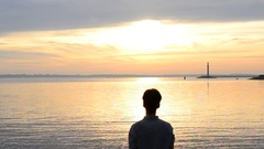 Silhouette of man practicing yoga at dawn Stock Footage
