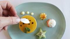 Hand of chef garnishing dessert food Stock Footage