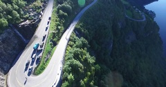 Aerial view of twisted road near geiranger fjord with cruise Stock Footage