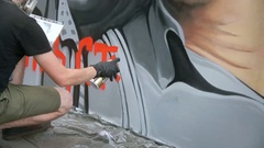 Street Artist Painting A Graffiti On The Wall Stock Footage