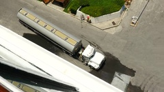 Top view 18 wheeler pulling away from near cruise ship Stock Footage
