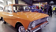 Exhibition of retro cars. Orange Moskvitch 412 Stock Footage