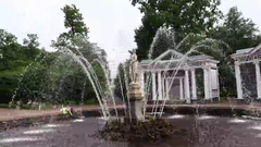 Old fountain in garden, orbiting shot, sprays rush from Eve sculpture basement Arkistovideo
