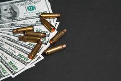 The used shell casings is on a money Stock Photos