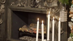 4K Close-up of a candle flame. Beautiful white candles burn on a festive Stock Footage