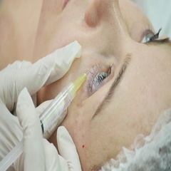 Mesotherapy. Beautiful woman gets an injection in her face Stock Footage