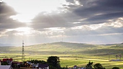 Sun Rays over the Green Hill Stock Footage