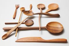 Assorted different kitchen wooden utensils cutlery Stock Photos