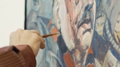 Close up of old painter draws historical picture Stock Footage