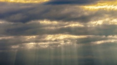 A ray of sunlight breaking through dark clouds Stock Footage