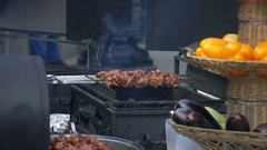 Pork Skewers Turning Automatically On Grill Stock Footage