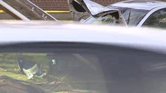 Car accident with car crashed into hydro pole Stock Footage