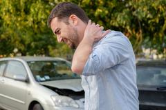 Man feeling bad after a car accident injury Stock Photos