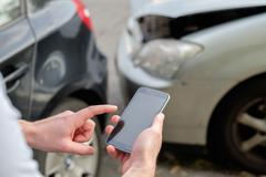 Mobile phone help calling after a car accident Stock Photos