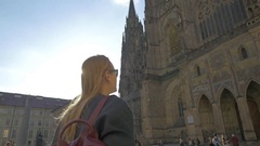 Woman tourist and St. Vitus Cathedral in Prague Stock Footage