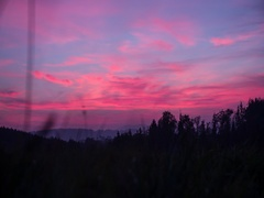 Dolly shot of hills and nature scenery before dramatic evening sky Stock Footage