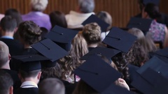 Graduates watching diploma awarding ceremony at university, higher education Stock Footage