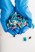 Hands full of medication. Tablets and pils Stock Photos