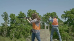 Woman and man skeet shooting target practice Stock Footage