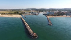 Flying over the entrance to the Marina dock. Vilamoura Stock Footage