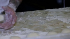 Baker making bread, man hands, kneading dough, cooking coat Stock Footage