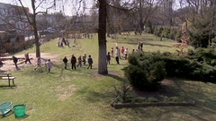 Children playing outside kindergarden on a grass, Stock Footage