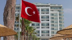 Turkish flag waving in blue sky with the building on the backgroud Stock Footage