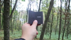 Travel idea, book with text . Forest in the background Stock Footage
