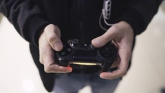 Man playing with a videogame controller in his hands Stock Footage