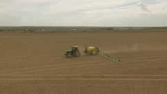 Spring field with a tractor Round shot Tractor turns right Stock Footage