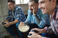 Watching video game Stock Photos