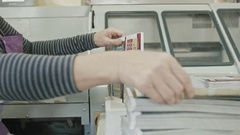 Polygraph printing process - a woman's hand completes a paper for a magazine Stock Footage