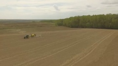 Spring field with a tractor Round shot Stock Footage
