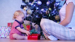 Christmas gift with light surprise. Mother and her Little baby boy Stock Footage
